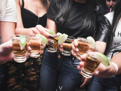 women-holding-shot-glasses-1304473